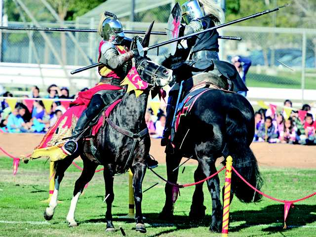 Kodie McAulay, left,  and Jason Houlihan perform a jousting demonstration at Bridgeport Park in Valencia on Thursday. (Dan Watson/The Signal)