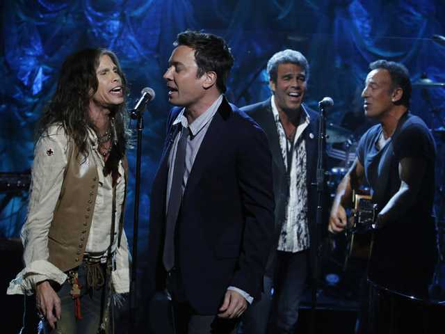 "Steven Tyler, Jimmy Fallon, Mark Rivera, and Bruce Springsteen, perform during ""Hurricane Sandy: Coming Together"" Friday."