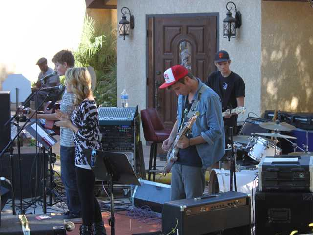 From left, Karson Gibson, Breanna Harris, Brendan Ashley, Garrett McGrath and Tommy Sweet perform at Project J at Village Church in Newhall on Sunday. The event had live bands, fellowship and prizes.