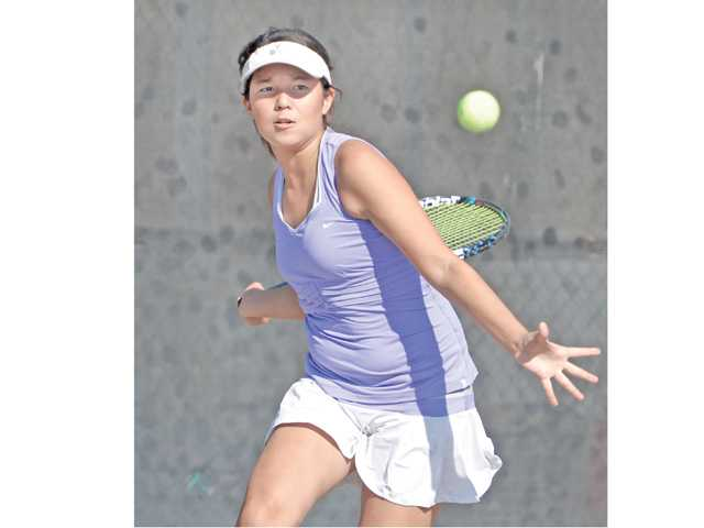 Valencia singles player Sabrina Wueste competes against Anaheim Canyon at Valencia on Friday.