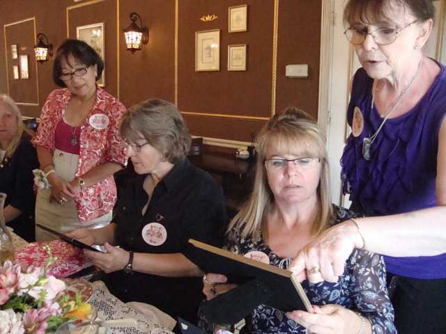 SCV Gold Star Mothers view a few of the gifts they were presented during the first SCV Gold Star Mother's Day Tea.