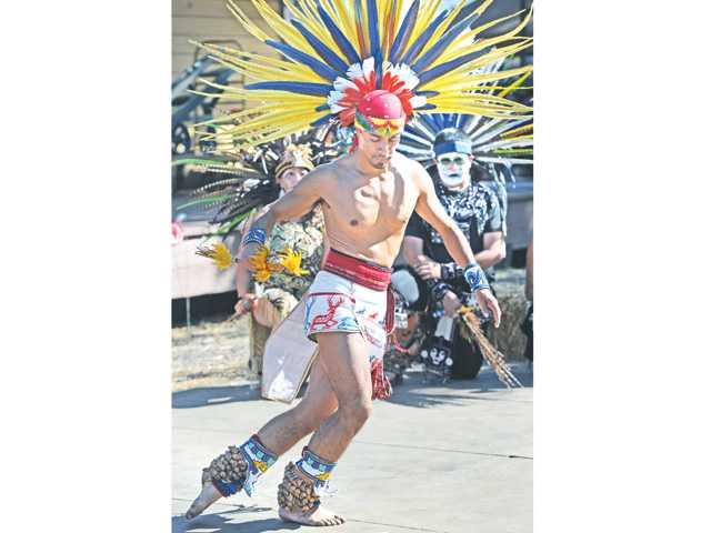 Aztec dancer Joaquin Chavez dances to honor ancestors at the Dia de los Muertos Festival held at Heritage Junction in Newhall on Saturday.