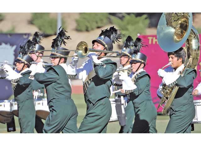 The Gold Star Brigade of Canyon High School performs at the Hart Rampage at College of the Canyons in Valencia on Saturday.