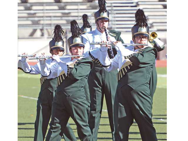 The Gold Star Brigade of Canyon High School performs at College of the Canyons in Valencia on Saturday.
