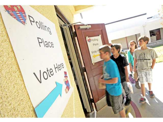 Students file into the computer lab at Sulphur Springs Community School in Canyon Country as they participate in a mock presidential election.