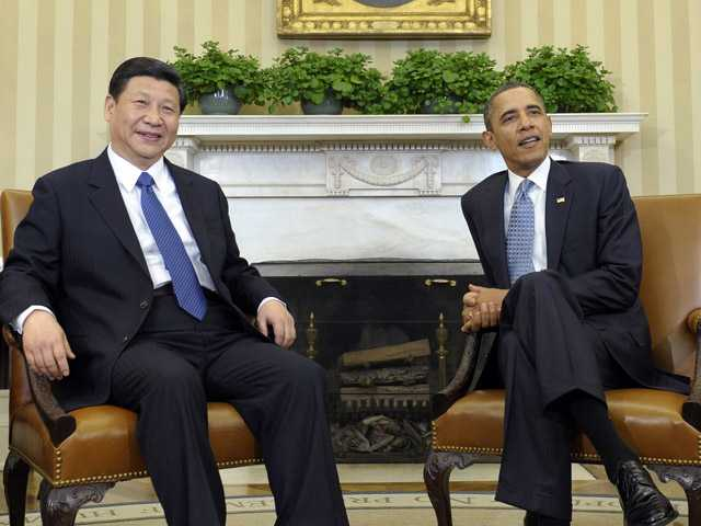In this photo taken Feb. 14, 2012, Chinese Vice President Xi Jinping, left, meets with President Barack Obama in the Oval Office of the White House in Washington.