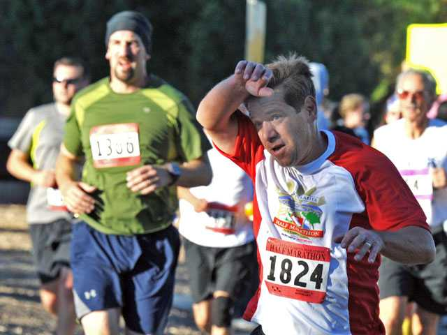 Richard Scholl, of Saugus, approaches the 3-mile mark in Valencia during the Santa Clarita Half Marathon on Sunday.