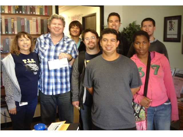 From left, Heidi Moody, instructional aide at TLC; Mike Kessler from the American Cancer Society, students Jacob Weitzman, Casey Gilruth, Ramon Aguilar, Ryan Bullard, Sydny Ejedaew and Arturo Ceballos.