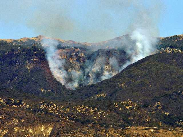 The Lookout Fire burns in the Painted Cave area of Santa Barbara, Calif., Wednesday, Oct. 17. The wildfire in the rugged hills overlooking Santa Barbara threatened about 100 homes in the area.