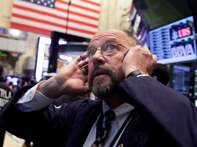Frederick Reimer works on the floor of the New York Stock Exchange. Trading is expected to be light on Election Day Tuesday, Nov. 6, 2012, as many investors remain on the sidelines.