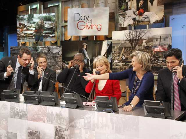 "From left, ABC News' Chris Cuomo, actor Tony Danza, actor Andre Braugher, Barbara Walters, Cynthia McFadden and David Novarro manning phones to take donations for victims of Hurricane Sandy during ""Good Morning America,"" Monday in New York."