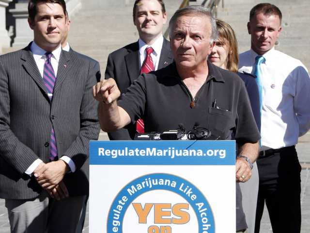 Former Republican U.S. Rep. Tom Tancredo, center, speaks out in favor supporting Amendment 64 to legalize marijuana in Colorado at the Capitol in Denver on Oct. 2, 2012. Amendment 64 would regulate marijuana like alcohol in Colorado.