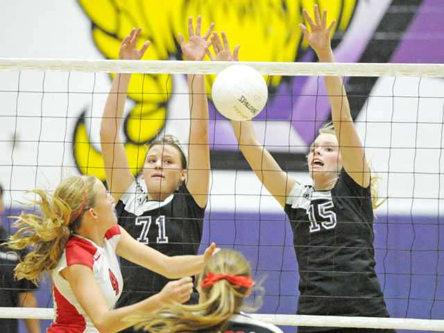 Valencia's Lindsey Knudsen (71) and Kellie Kleszcz (15) block a hit from Flintridge Sacred Heart's Madelyn Peterson (4) on Tuesday night at Valencia High in the first round of the CIF-SS Div. IA playoffs.