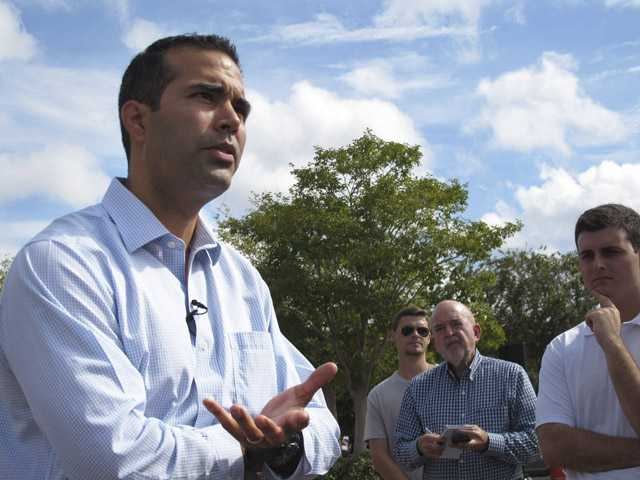 In this Sept. 17 photo, George P. Bush speaks with Florida State University students before beginning a bus tour in Tallahassee, Fla.
