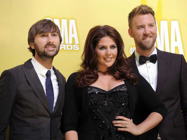 This Nov. 1 photo shows members of the band Lady Antebellum, from left, Dave Haywood, Hillary Scott and Charles Kelley at the Country Music Awards in Nashville, Tenn.