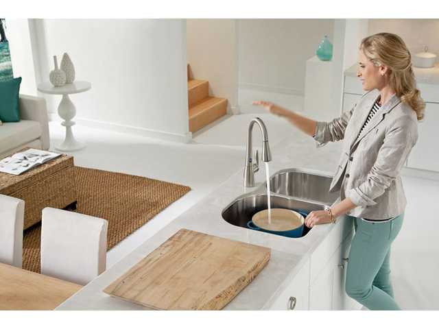 MotionSense from Moen utilizes advanced sensors to detect a user's movement in two sensing zones, immediately setting water flow in motion.