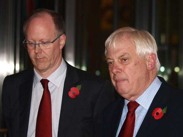The BBC Director General, George Entwistle, left, stands with the Chairman of the BBC Trust, Lord Chris Patten, as he announces his resignation.