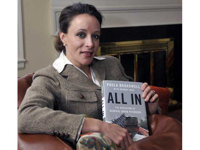 "Paula Broadwell, author of the David Petraeus biography ""All In,"" poses for photos in Charlotte, N.C."