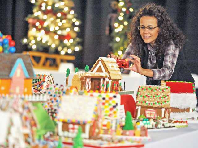 Aleda Baker, of Castaic, checks out gingerbread houses at the Festival of Trees in Valencia on Friday.