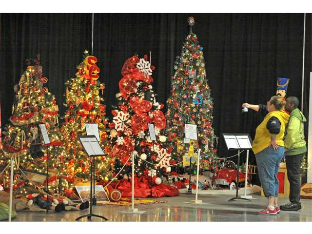 Nanette Thomas and Sherry Miller, of Burbank, look at decorated trees on the first day of the Festival of Trees at Westfield Valencia Town Center on Friday.