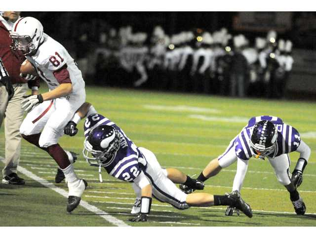 Valencia's Spencer Hixon (22) and Cole Chadwell (11) force paso Robles' Bailey Gaither (81) out of bounds on Friday at Valencia High in the CIF-SS Northern Div. playoffs.