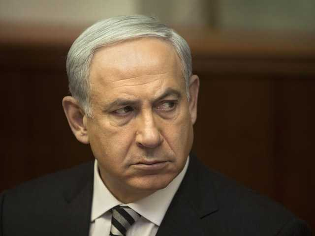 Israeli Prime Minister Benjamin Netanyahu attends the weekly cabinet meeting in his Jerusalem office.