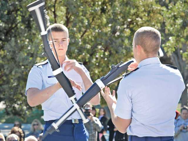 Mark Lowery, left, and brother Thomas of the Valencia High School Junior ROTC exhibition rifle team perform. (Dan Watson/The Signal)