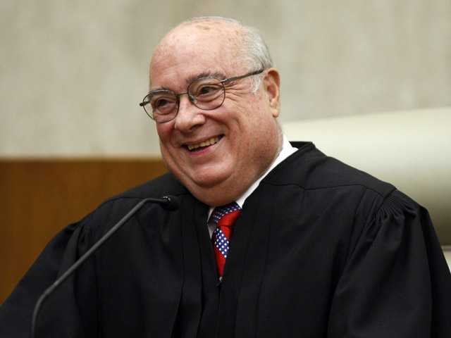 In this May 1, 2008, photo, Chief Judge Royce Lamberth of the U.S. District Court in Washington is pictured during a ceremony  in Washington .