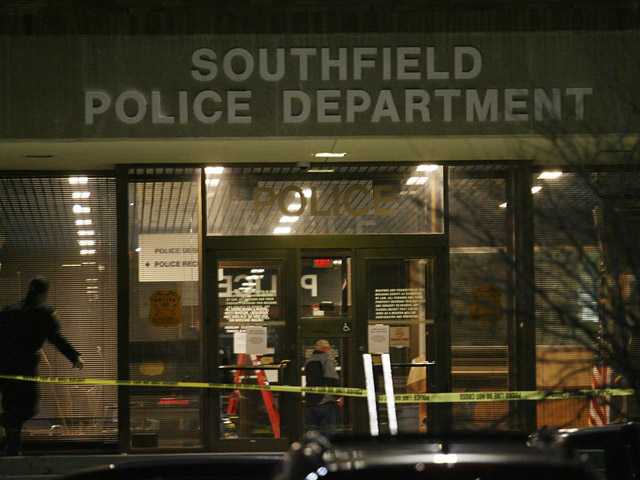 Caution tape blocks the entrance of the Southfield Police Department, Sunday in Southfield, Mich.