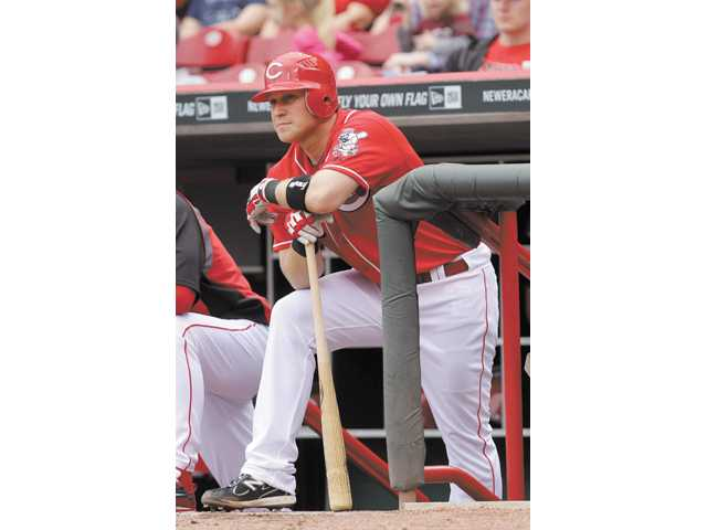 Former Cincinnati Red and Hart High graduate Chris Valaika waits in the dugout during an MLB game against the Florida Marlins on May 1, 2011.
