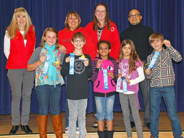 (Back row from left) Gayle Abril; principal of Golden Oak Community School; teachers Deanna Tapia and Amy Bove; Phillip Solomon, chief operating officer of Samuel Dixon Family Health Centers; (Front row from left) Student winners from Golden Oak Community School Annie Niednagel, (poster winner); Katelyn Sulett (essay winner); and honorable mentions Namita Shyam, Delany Pinedas and Ethan Dempsy.