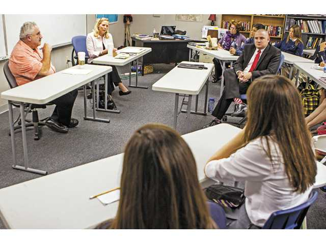 Trinity 12th grade U.S. government teacher Chris Leigh moderates a debate between Michael Kulka, president of the Democratic Alliance for Action and Lynn Haueter, chair of the Republican Party of Los Angeles.
