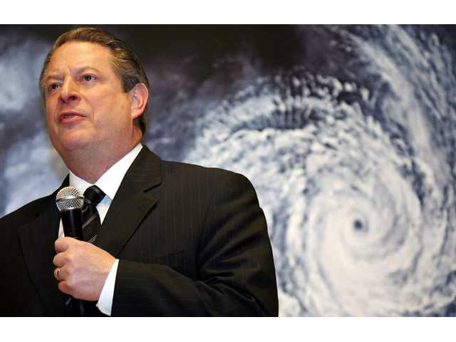 "Al Gore speaks in front of a poster for his documentary film on global warming, ""An Inconvenient Truth,"" during the Japanese premier in Tokyo."