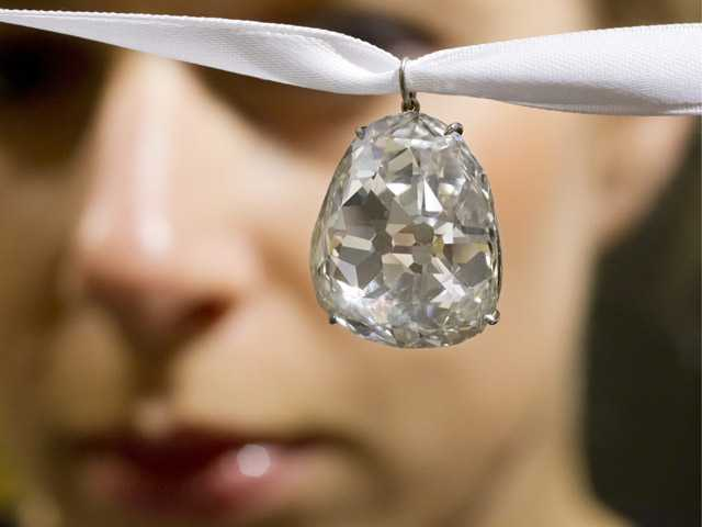 An employee shows the Beau Sancy diamond, 34.98 carat, at Sotheby's auction house in Zurich, Switzerland.