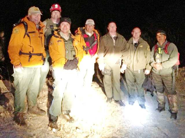 The Search and Rescue team is pictured at the scene after they saved a 57-year-old hiker who was stuck on the side of a cliff for more than five hours.