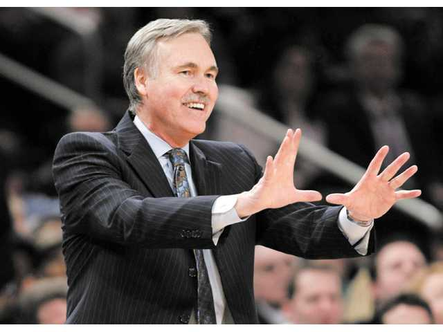 Former New York Knicks coach Mike D'Antoni gestures during a game against the Atlanta Hawks on Feb. 22 in New York. It was announced Monday that D'Antoni will take over as the Lakers' new head coach.