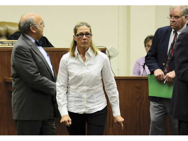 Former Dixon, Ill., comptroller Rita Crundwell leaves a courtroom in Dixon after making her first appearance in the northern Illinois city to face charges she siphoned millions of dollars in public funds into a secret bank account.