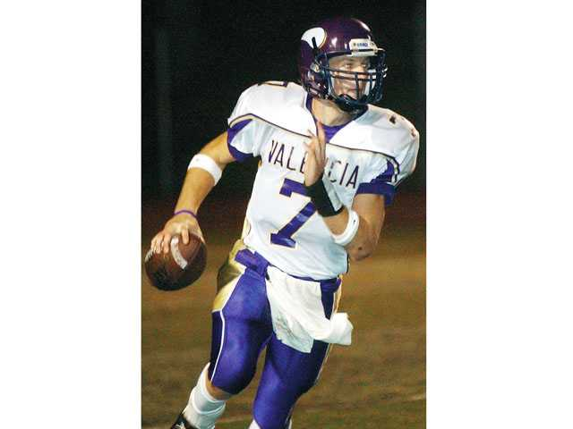 Former Valencia quarterback Michael Herrick owns multiple state passing records.