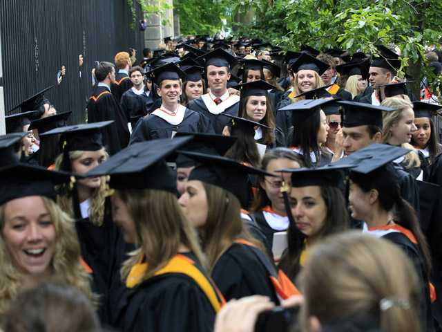 In this June 5 photo, friends and family greet a procession of the graduating class of 2012 at Princeton University after commencement ceremonies in Princeton, N.J.