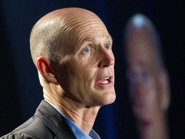 "Florida Gov. Rick Scott speaks. Scott, one of the most visible opponents of Obama's overhaul, now says ""if I can get to yes, I want to get to yes."""