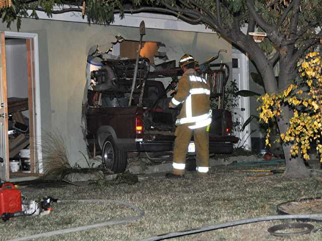 A pickup truck carrying gardening tools left the roadway and crashed into a Santa Clarita garage on Thursday evening.