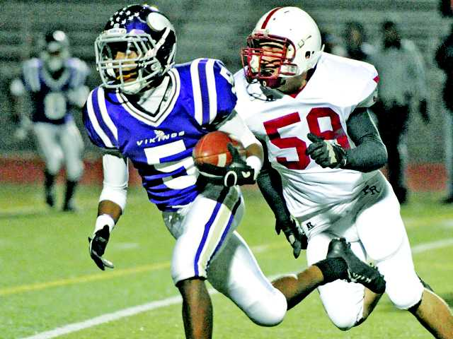 Valencia running back James Brerkley tries to outrun Paso Robles defenders on Nov. 9 at Valencia High.