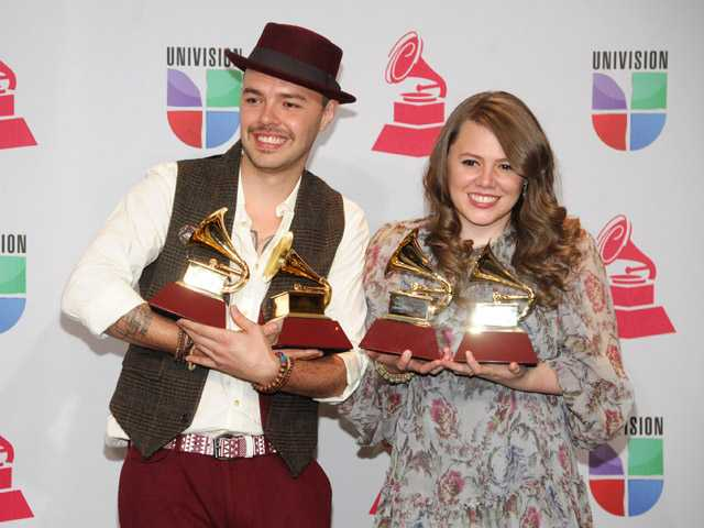 "Jesse & Joy pose backstage with the best contemporary pop vocal album award for ""Con Quien Se Queda el Perro"" and song of the year for ""Corre!"" at the 13th Annual Latin Grammy Awards at Mandalay Bay on Thursday, Nov. 15, 2012, in Las Vegas."
