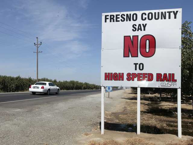 In In this Sept. 13, file photo a sign against the proposed high-Speed rail system is seen on Highway 43 near Hanford.