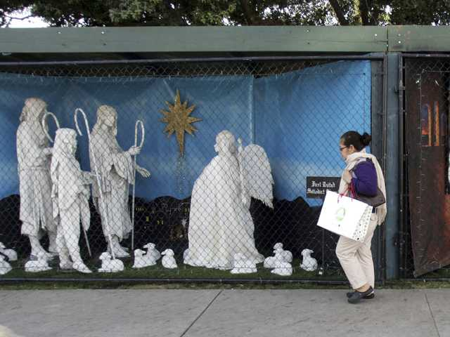 "A Nativity scene along Ocean Avenue at Palisades Park in Santa Monica. Avowed atheist Damon Vix last year won two-thirds of the booths in the annual, city-sponsored lottery to divvy up spaces in the live-sized Nativity display. But he only put up one thing: A sign that read ""Religions are all alike - founded on fables and mythologies."""