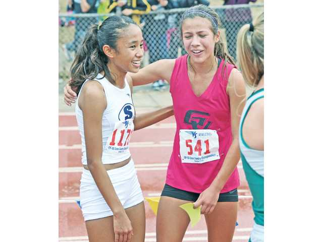 Saugus' Samantha Ortega, left, and Golden Valley's Bianca Tinoco congratulate each other after the Division II race at Mt. SAC on Saturday.