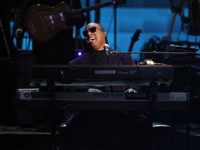 "Stevie Wonder and the Rickey Minor Band perform ""Master Blaster"", ""My Cherie Amour"" and ""Sir Duke"" as a tribute to Dick Clark at the 40th Anniversary American Music Awards on Sunday, in Los Angeles."