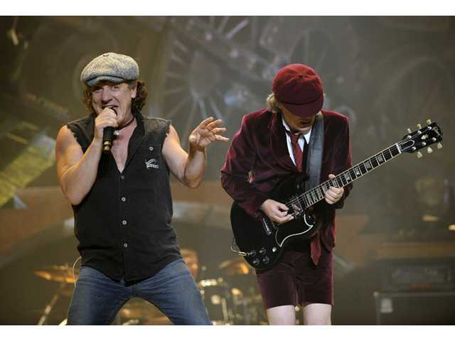 AC/DC lead singer Brian Johnson, left, and Angus Young perform on the Black Ice tour at Madison Square Garden in New York.
