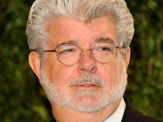 George Lucas at the Vanity Fair Oscar party in West Hollywood, Calif. Feb. 26. Disney announced Monday it is closing its online movie store.