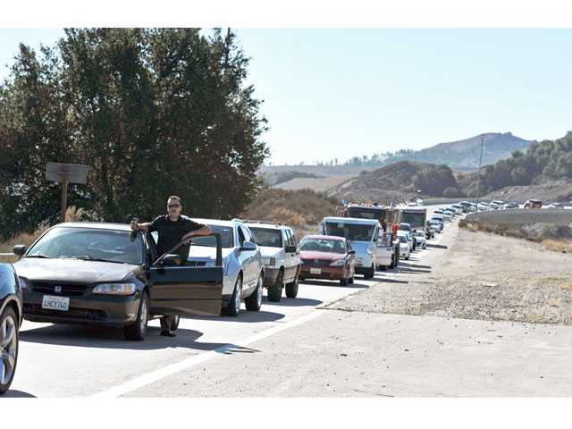 Motorists are stopped on the on-ramp from southbound Interstate 5 to northbound Highway 14 as crews worked to clear wires on Highway 14 in Newhall on Tuesday. (Jonathan Pobre/The Signal)